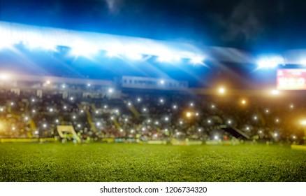 Football stadium, tribunes with fans, shiny lights