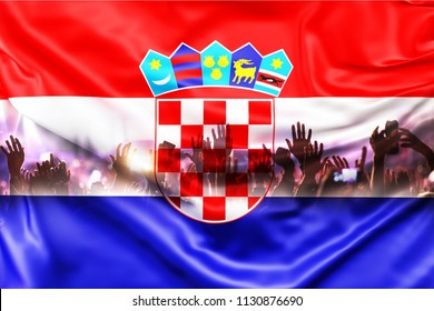 football supporters with raised hands against Croatia flag - crowd in stadium celebrating victory