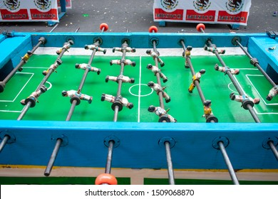 Football table, as a play game in a mexican fair. This is an old object, made of wood, with brighting colors.