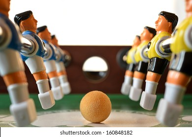 football table players and the ball