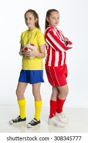 Football team captains looking competitive. They are standing back to back against a white background whilst looking at the camera.