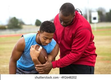Football training day. American Football.  Football coach training an athlete.