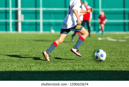 Football training soccer for kids. Boy runs kicks dribbles soccer balls. Young footballers dribble and kick football ball in game. Training, active lifestyle, sport, children activity concept