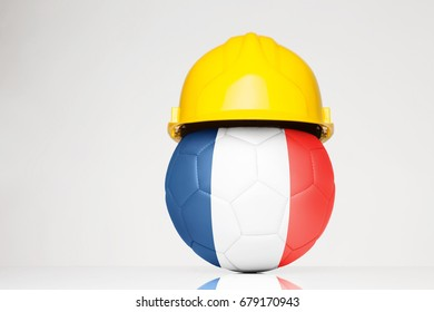 Football wearing a hard hat with the France flag superimposed on the football