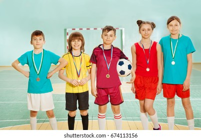 Football winners standing in line with medals