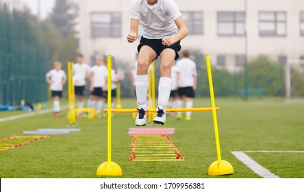 Footballers on Practice Session in Field on Sunny Day. Soccer Player on Fitness Training. Young Soccer Players at Speed and Agility Practice Training Session