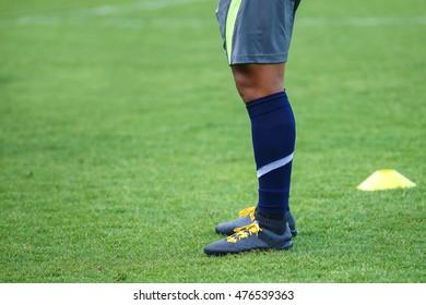 Football's player standing on green grass.