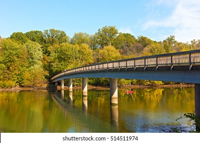 Footbridge bridge to the Theodore Roosevelt Island in Washington DC, USA. Kayaking on Potomac River in early autumn.