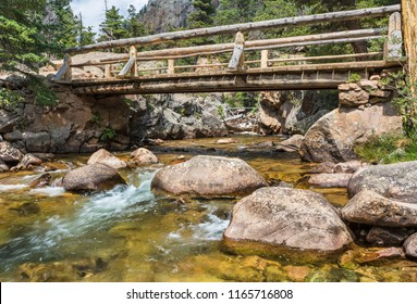 A footbridge carries the Fern Lake Trail over The Pool on the Big Thompson River in Rocky Mountain National Park, Colorado.