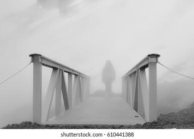 Footbridge in the fog over the thermal stream near Reykjavik.
