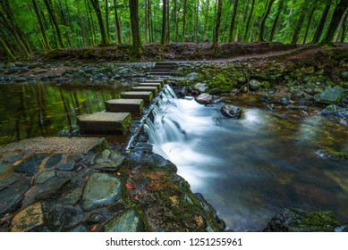 Footbridge over the the Shimna River made of stepping stones in the Tollymore Forest Park located at Bryansford, near the town of Newcastle, Northern Ireland