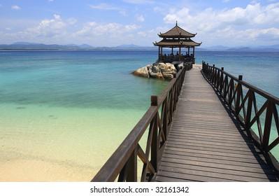 Footbridge to pavilion at beach of Wuzhizhou Island