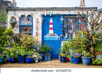 Footdee, Aberdeen, Scotland- 28/04/2019. A cottage with a blue door in Footdee, Aberdeen.