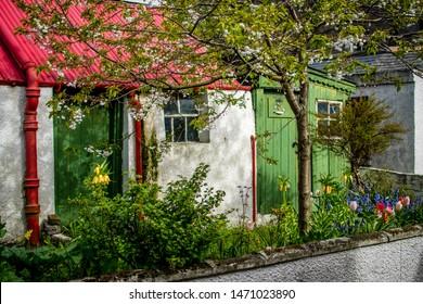 Footdee, Aberdeen, Scotland- 28/04/2019. A cottage with a green door in Footdee, Aberdeen.