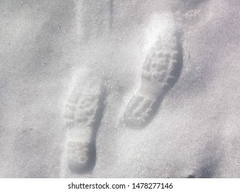 Footmarks on the clean snow surface. Abstract background