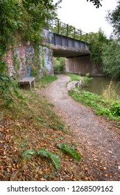Footpath along side a canal and under a bridge