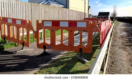 Footpath closed fenced off area work in bright sunshine