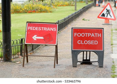 Footpath Closed and Pedestrians this way with direction arrow