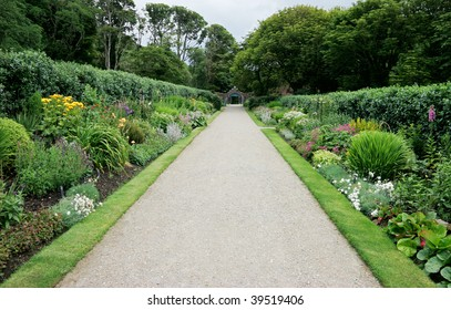 Footpath in a lush and colorfull Irish garden
