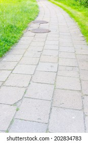 Footpath made of stone tiles