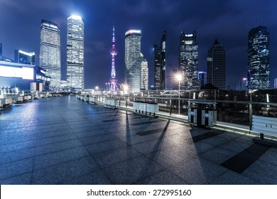 footpath and modern buildings at night
