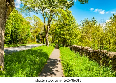 Footpath next to a wall and road. Chipping Norton