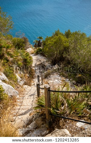 A footpath on the Rock of Gibraltar. Gibraltar is a British Overseas Territory located on the southern tip of Spain