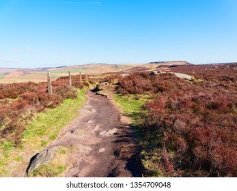 Footpath over the Derbyshire Peak District to Higger Tor in the far distance