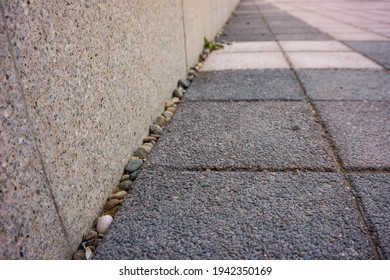 footpath with parapet and paving slabs