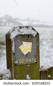 Footpath sign pointing you the right direction in the snow