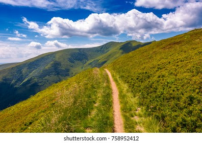 footpath through grassy mountain ridge. beautiful summer landscape under gorgeous sky with clouds