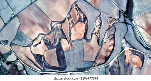 the footprint of the human being, tribute to Picasso, abstract photography of the Spain fields from the air, aerial view, representation of human labor camps, abstract, cubism, abstract naturalism,