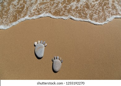 Footprint made of pebbles on the beach