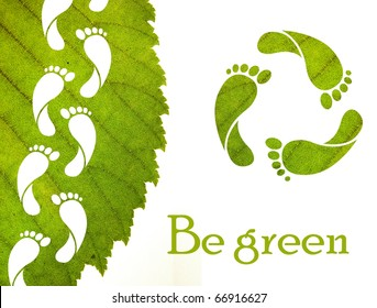 Footprint recycle sign and green leaf with foot carbon prints