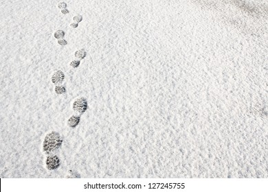 Footprints in fresh snow background great concept for winter footwear