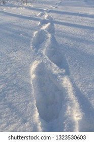 Footprints of a human in a deep snow. Missing person leaves trails.