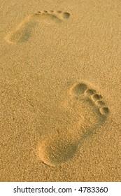 Footprints on beach sand
