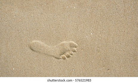 Footprints on the beach sand, Surface of human footmarks on smooth sand at the seaside, In summer, Texture background
