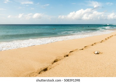 Footprints on sand of famous Banzai Pipeline beach in Oahu Hawaii