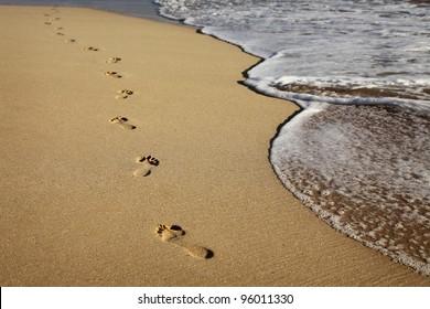footprints on a sandy beach