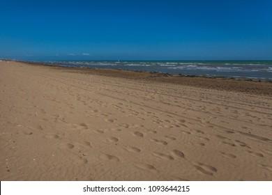 Footprints on sandy beach, Bibione, Veneto, Italy
