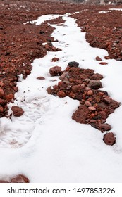 Footprints on the snow while climbing the rocky slopes of the Chimborazo volcano in Ecuador