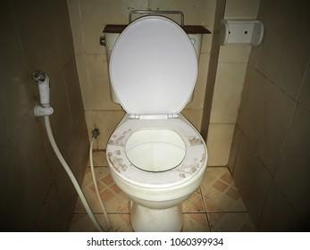 Footprints on the toilet, Behavior stupid concept.