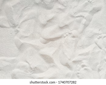 Footprints on white sand beach  background pattern - Image