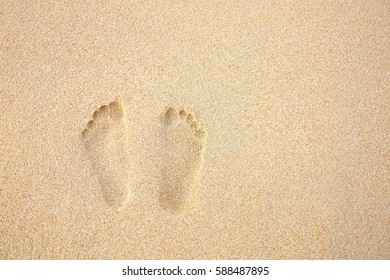 Footprints in the sand beach.