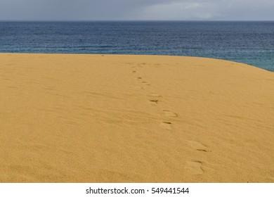 Footprints in sand dunes