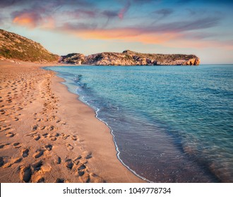 Footprints in the sand on the famous Turkish beach Patara. Colorful sunset in the Turkey, District of Kas, Antalya Province, Asia. Beauty of nature concept background.