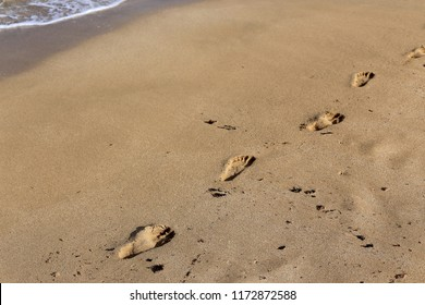 footprints in the sand on the Mediterranean coast