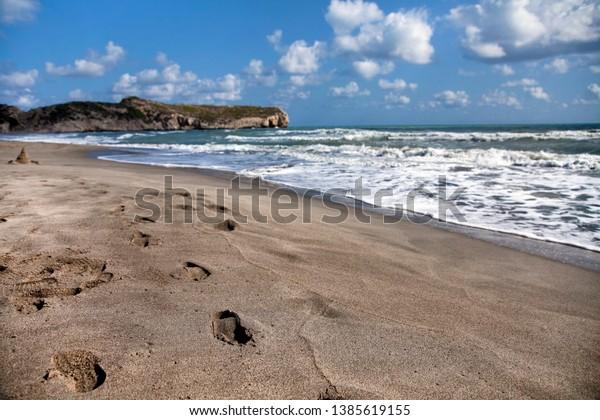 Footprints in the sand at the Patara beach, Turkey