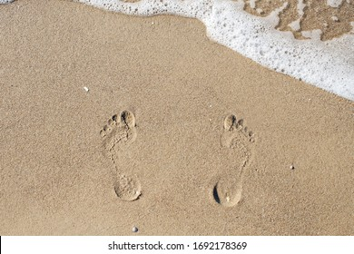Footprints in the sand. Sea. Ocean. The waves.